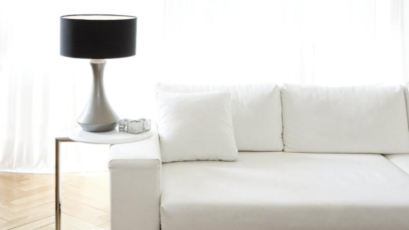 divano con penisola bianco ecopelle