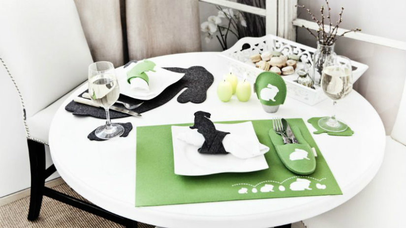 tavolo rotondo bianco tovagliette posate pasqua