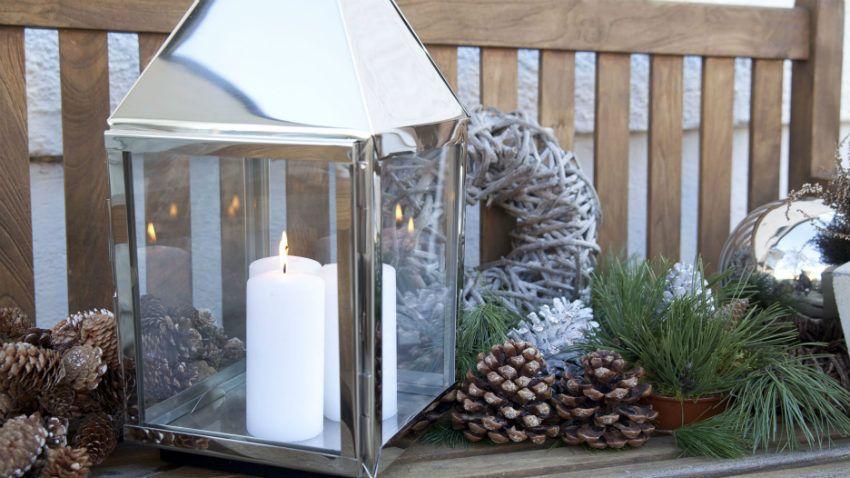 lanterne in acciaio e vetro candela ghirlanda