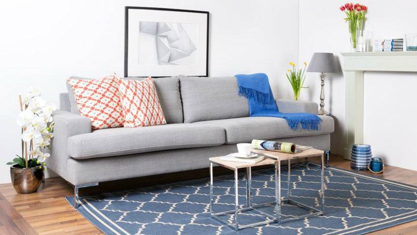 arredare il salotto tappeto tavolino divano quadro