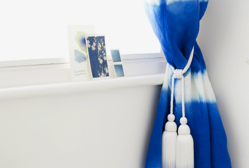 raamversiering boho interieur stijl blauw gordijnkwast fotolijst