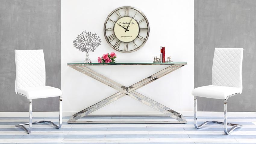witte designstoelen aan moderne tafel
