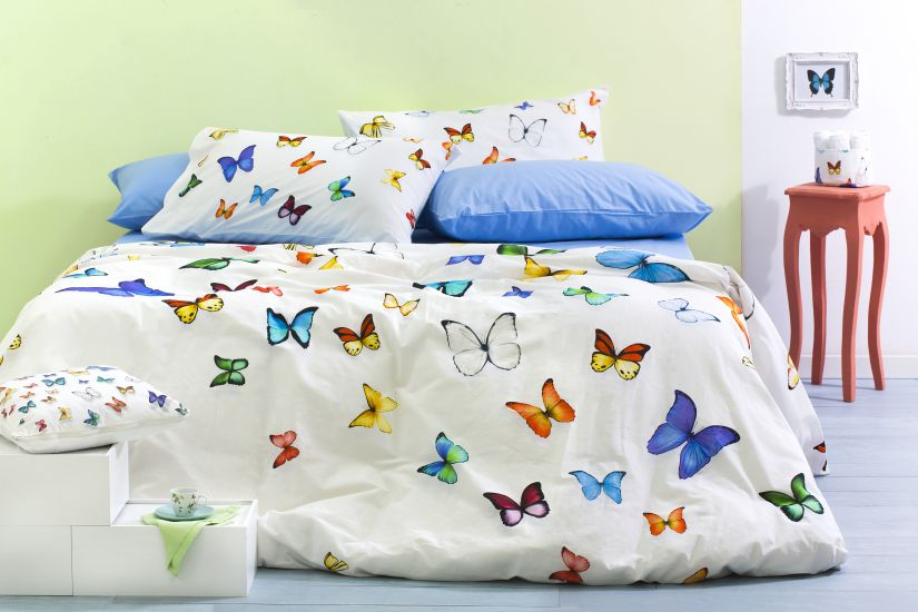junior dekbedovertrek met vlinders en blauw kussen