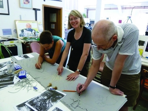 ELP members working on the giant lino print