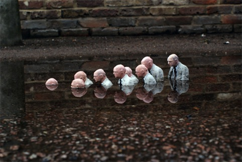 Follow the leader by Isaac Cordal