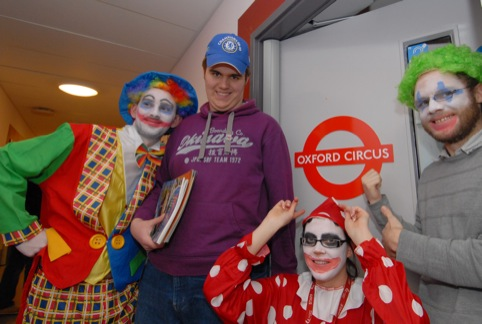 Orchard Hill College lecturers and student Luke Green celebrate their new Oxford Circus classroom