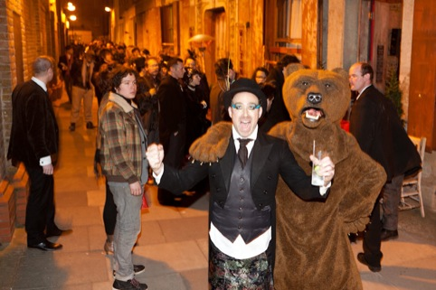 A bear and a guest outside Wilton's Music Hall