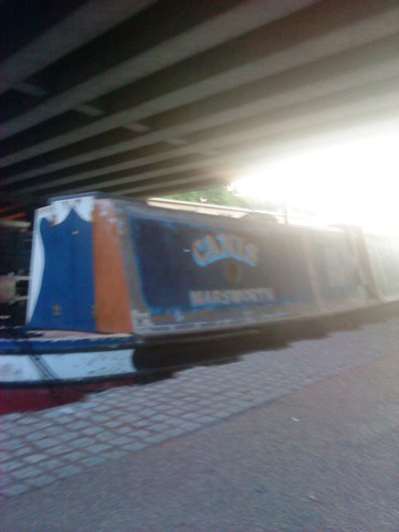 canal boat next to Folly for a Flyover