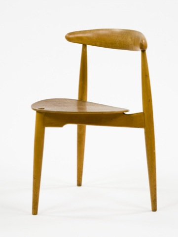 Three legged chair designed by Hans Wegner in 1949 and manufactured by Fritz Hansen in Denmark in c1960