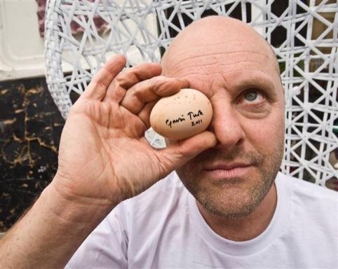 Gavin Turk holding an egg