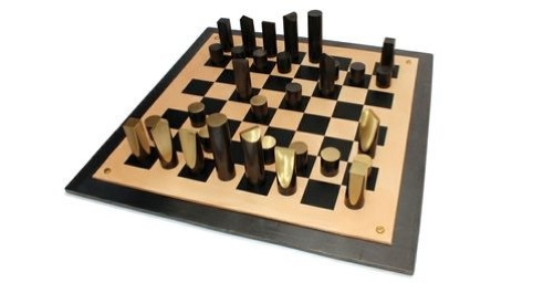 Chess Set, by Simon Hasan, 2012. Patinated brass, leather, hot-rolled steel plate.