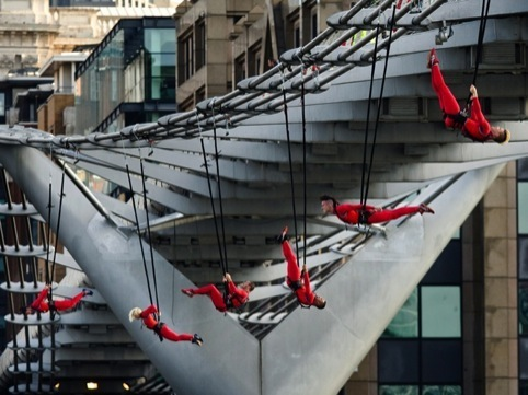 Dancers dangle from the Millennium Bridge