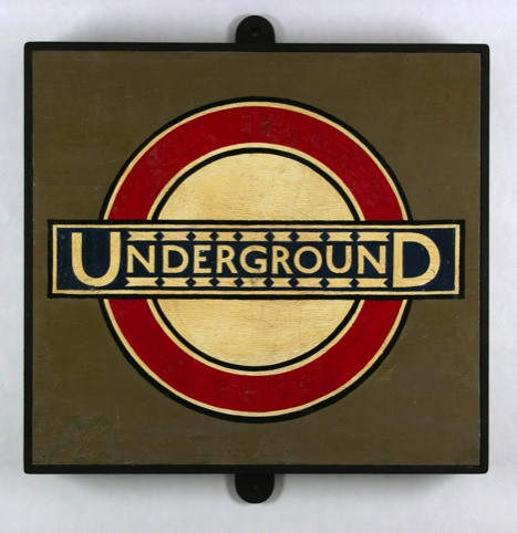 Underground roundel from Westminster Station, c.1930. By Edward Johnston