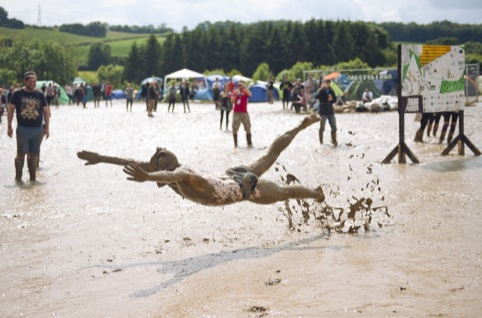 Sally Rose McCormack – Man diving into mud…, winner of Festivals category