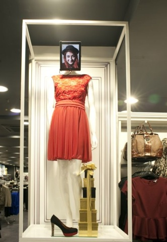Tablet on mannequin's head greets customers
