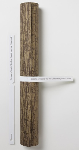 Rolled-up poster with tree tag.