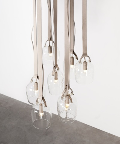 Bells-lights: Discarded Fendi leather, glass, leather-covered hooks, leather-covered electric wire.