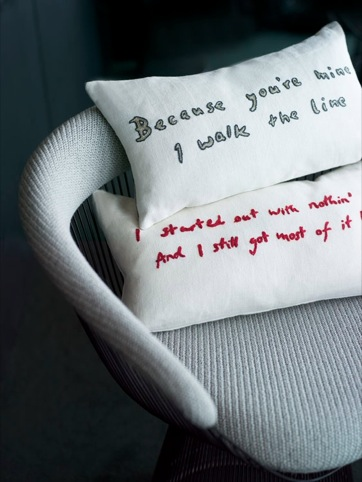 Lyrics from Johnny Cash and Seasick Steve songs used to decorate cushions