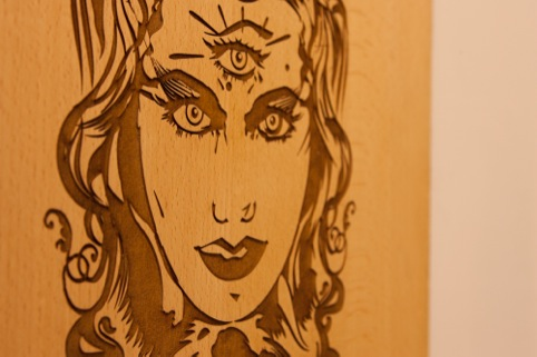 Wooden engraved face by Melbs (Chris Malbon)