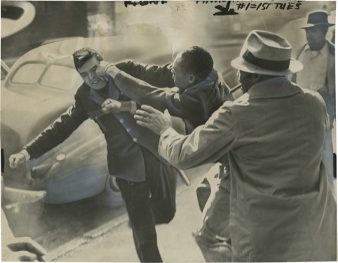 "Striker Lands a ""Roundhouse"" on Police Officer's Jaw, Ed Smith October 2, 1946"