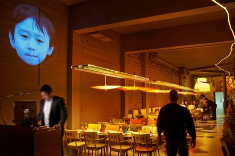Asian faces wall projection
