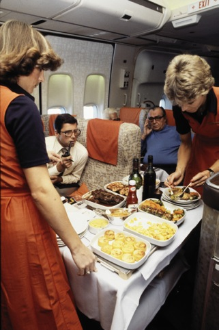 Hostesses serving a meal in a Boeing 747-257, 1978