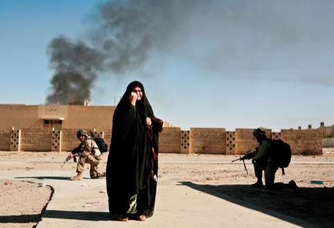 An Iraqi woman caught up in fighting between insurgents and Coalition troops, Ubaydi, 2005