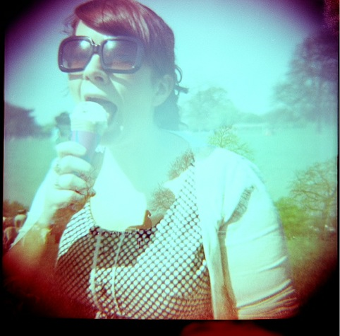A lady mid ice-cream, shot with a Diana2 camera