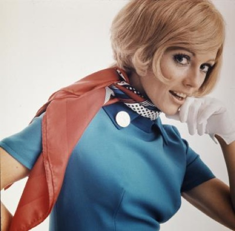 A model wearing the Swissair hostess1960 - 1970 uniforms