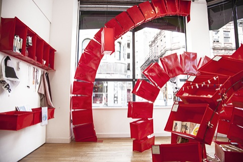 Red Chinese-inspired display arcs in the Poundshop interior
