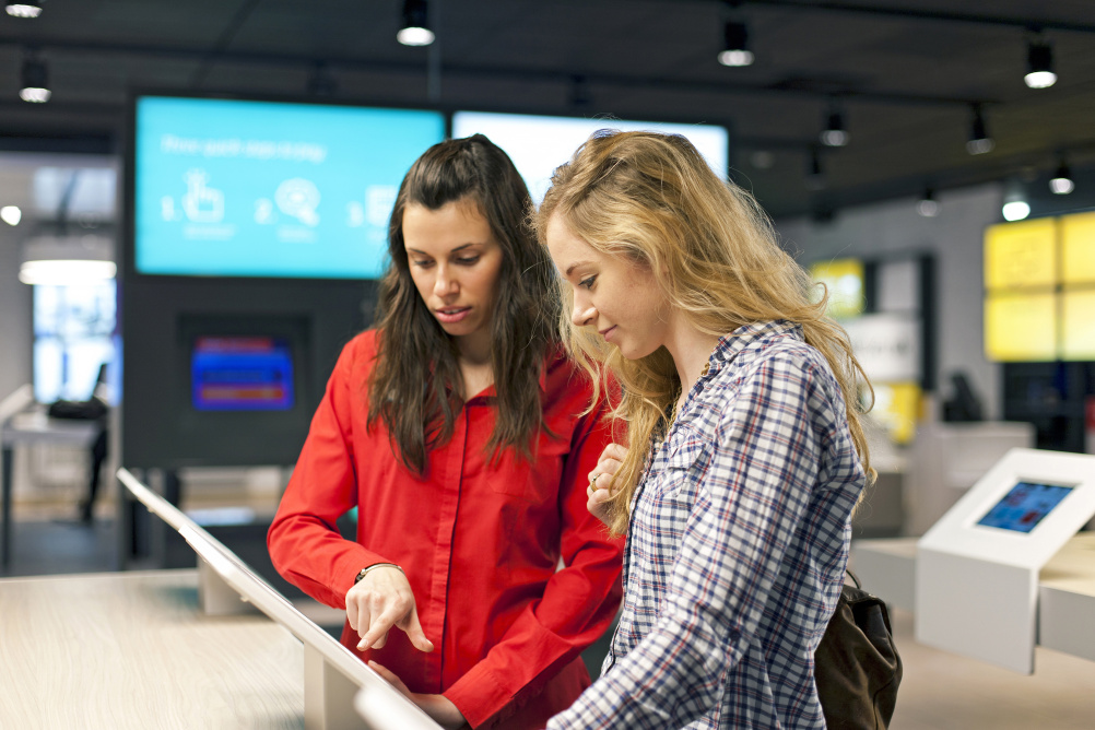 Shoppers using the new store technology
