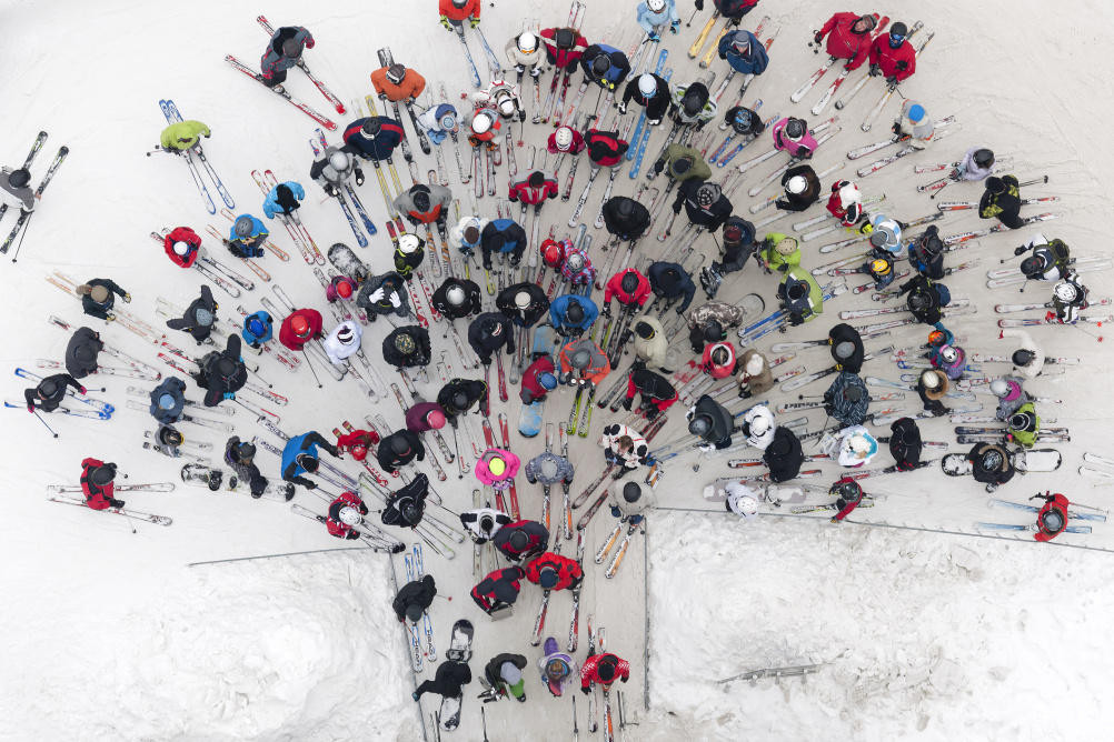 Skiers in a landscape by Kacper Kowalski