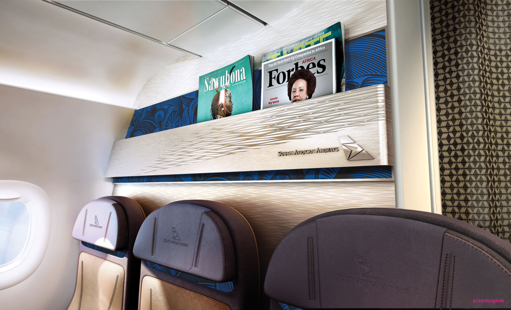 Economy class features wall-mounted magazine racks with a textured linear weave design and a deep blue African print foil background.