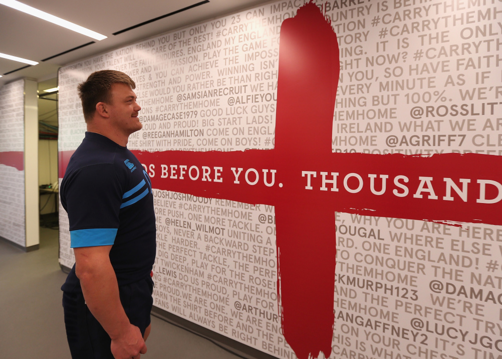 England's David Wilson reads messages of support from fans