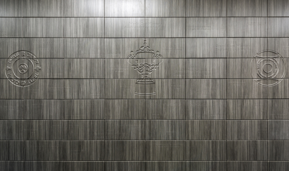 An engraved wall shows the England rugby team's achievements