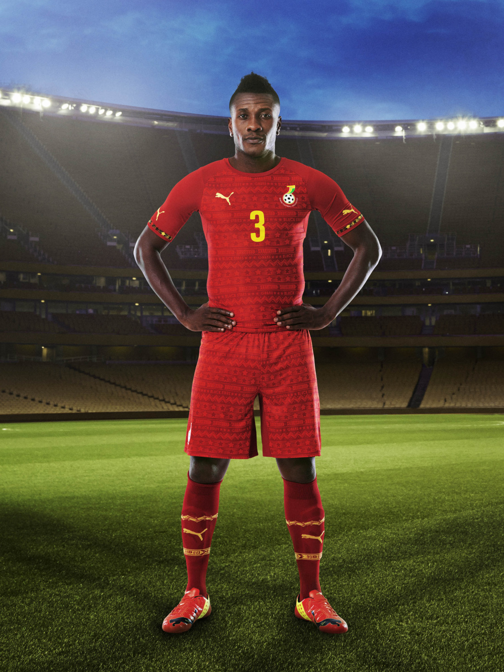 Ghana home shirt modelled by captain Asamoah Gyan