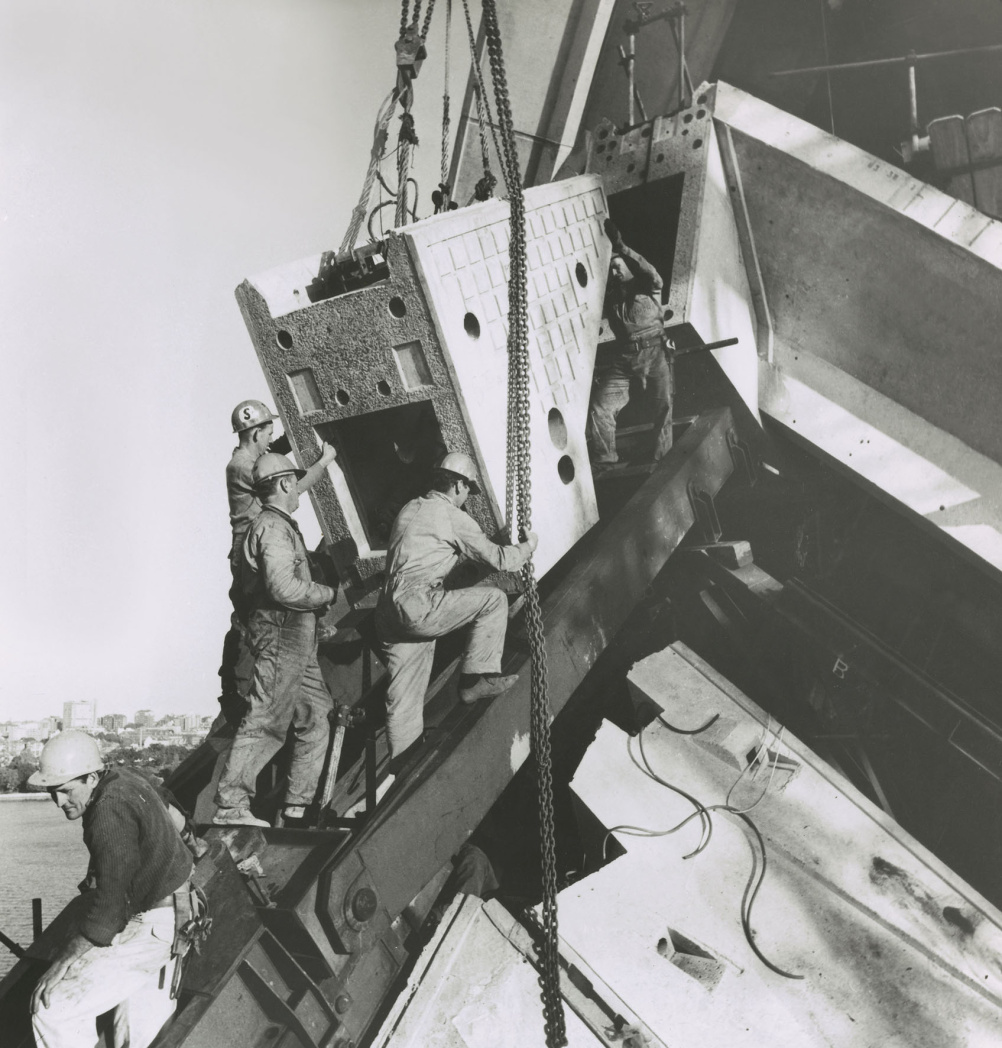 Installing a ridge beam segment on main shell, 1966