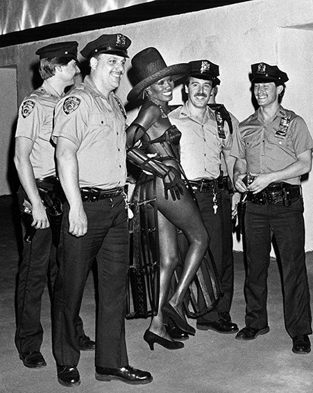 Ron Galella: Grace Jones and Police Officers, 1989