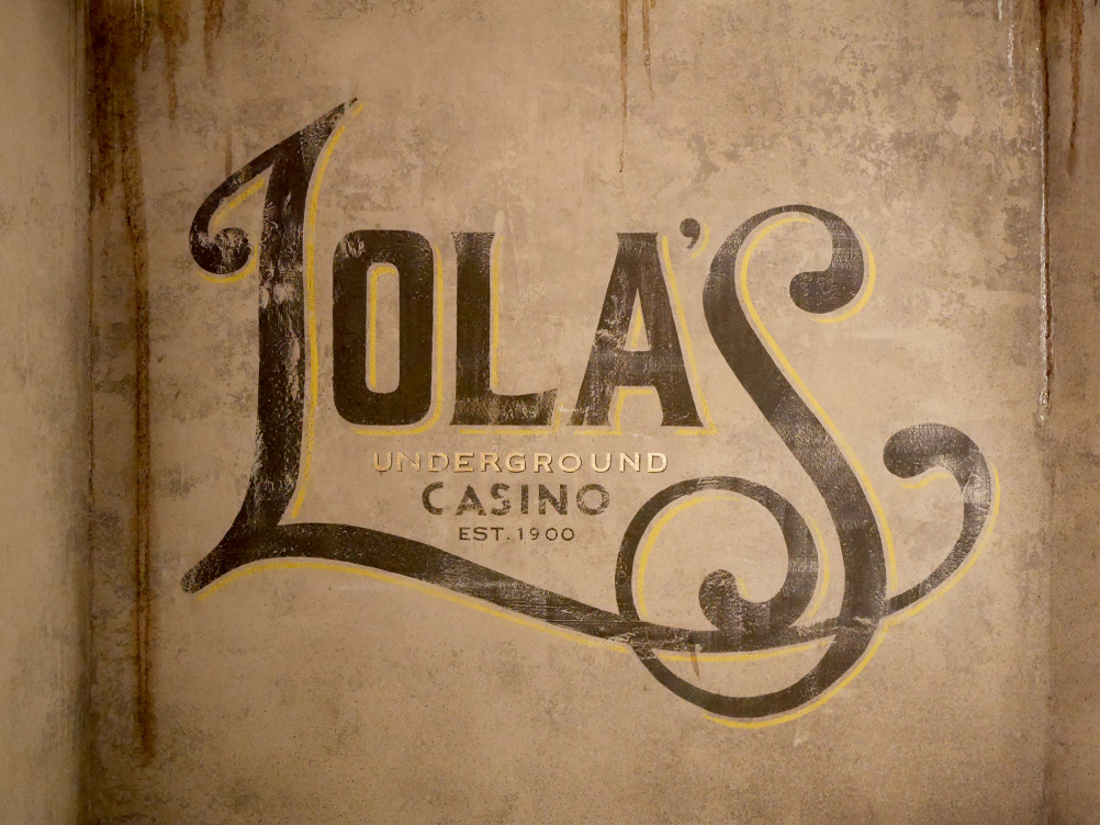 The identity is hand-painted on the walls of the venue