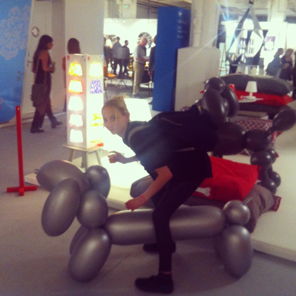 Astride a large inflatable Jeff Koons-esque dachshund