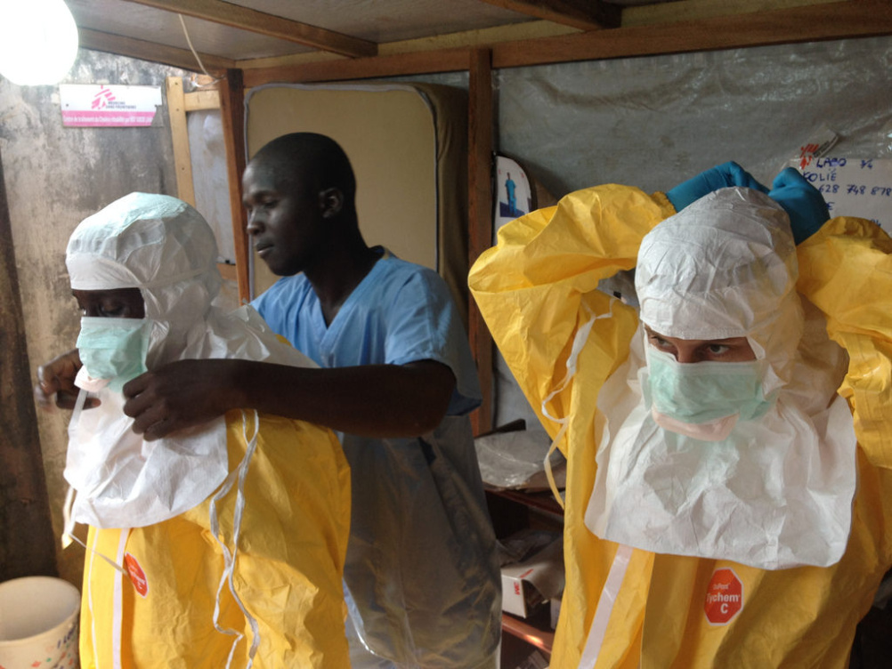 Healthcare workers in Guinea don protective suits as they prepare to tackle the Ebola epidemic