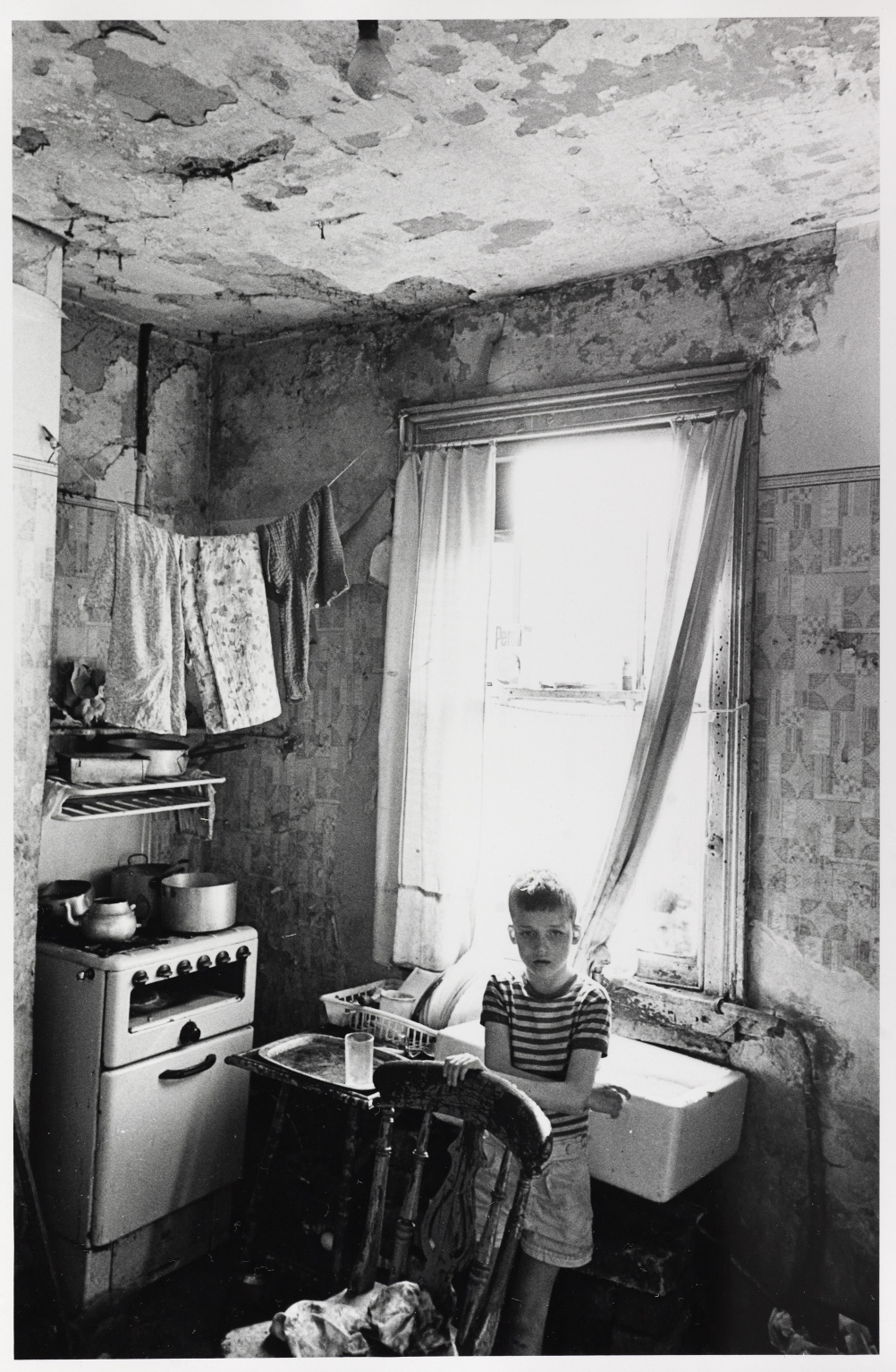 Kitchen of slum house, Birmingham Duddleston, August 1970