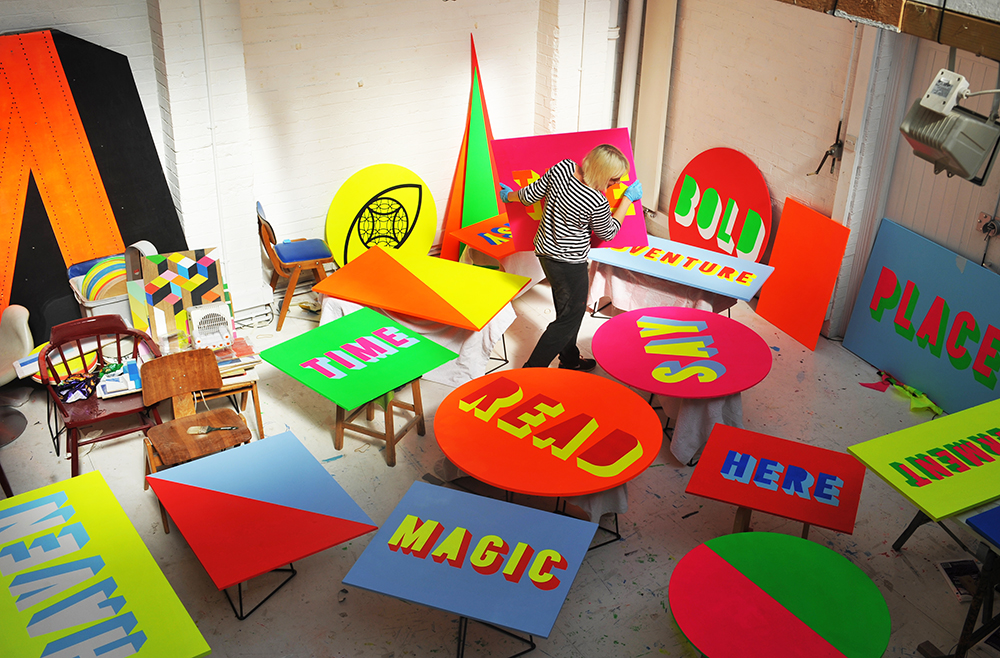 Morag Myerscough painting signs at Studio Myerscough