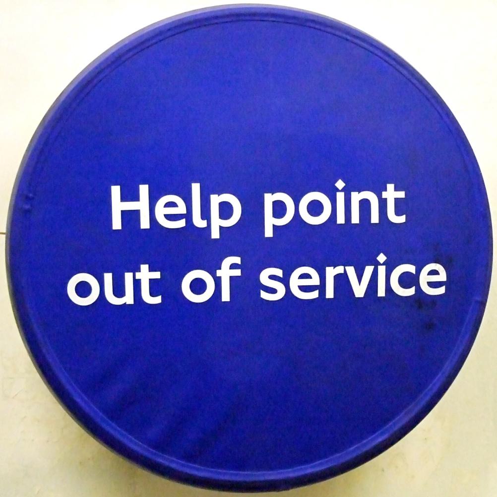 "London Underground sign – showing the diamond-dot ""i"""