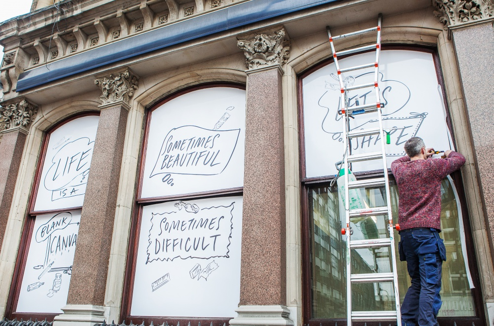 Window displays to promote the testing. Image by Philip Volkers Photography
