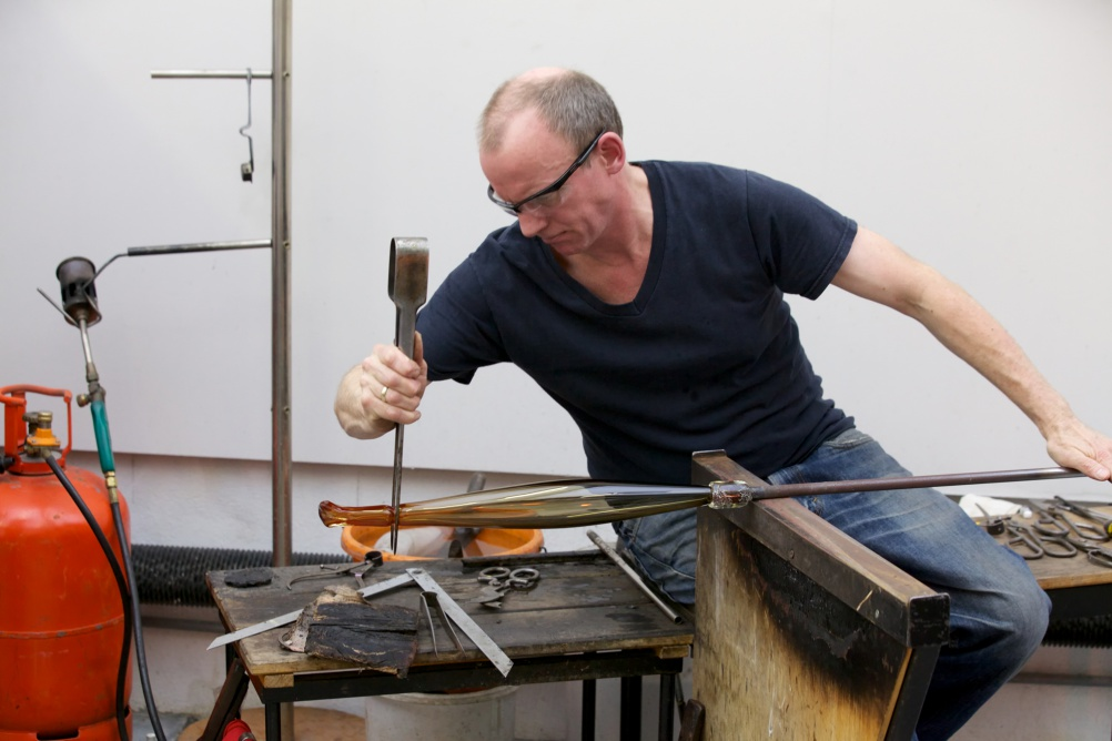 Michael Ruh in his glass-blowing studio in Tulse Hill, London
