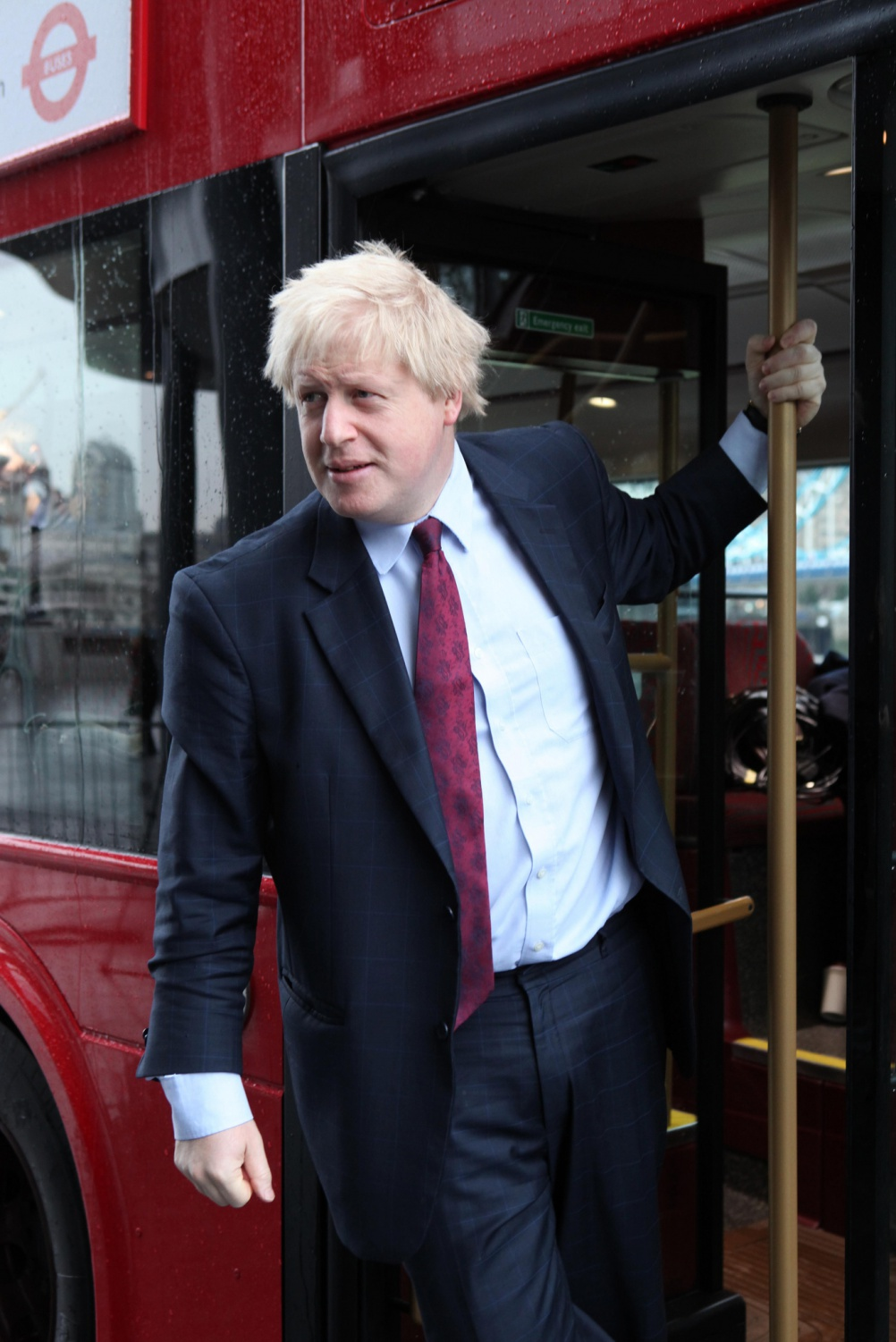 London Mayor Boris Johnson on the rear platform of the New Routemaster. Image by TfL