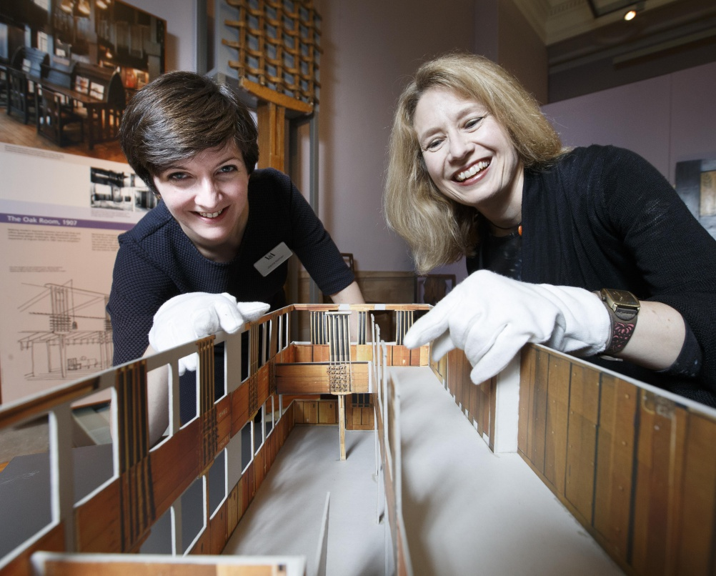 Mackintosh Tearoom Restoration at V&A Dundee's Scottish Design Galleries. Left Joanna Norman, Senior Curator, V&A and right Alison Brown Curator, European Decorative Art from 1800. At the Kelvingrove Musuem in Glasgow with a scaled model of the Oak Room. Picture Robert Perry 8th July 2015 Must credit photo to Robert Perry Image is free to use in connection with the promotion of the above company or organisation. 'Permissions for ALL other uses need to be sought and payment make be required. Note to Editors:  This image is free to be used editorially in the promotion of the above company or organisation.  Without prejudice ALL other licences without prior consent will be deemed a breach of copyright under the 1988. Copyright Design and Patents Act  and will be subject to payment or legal action, where appropriate. www.robertperry.co.uk NB -This image is not to be distributed without the prior consent of the copyright holder. in using this image you agree to abide by terms and conditions as stated in this caption. All monies payable to Robert Perry (PLEASE DO NOT REMOVE THIS CAPTION) This image is intended for Editorial use (e.g. news). Any commercial or promotional use requires additional clearance.  Copyright 2014 All rights protected. first use only contact details Robert Perry      07702 631 477 robertperryphotos@gmail.com         Robert Perry reserves the right to pursue unauthorised use of this image . If you violate my intellectual property you may be liable for  damages, loss of income, and profits you derive from the use of this image.