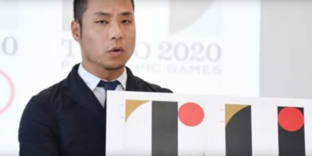 Kenjiro Sano defends his logo in a press conference