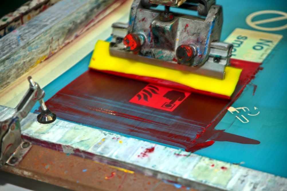 Print shop screen printing workshop. Making fire escape stickers.